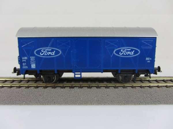 Basis ROCO Tonnendach Güterwagen blau mit Beschriftung FORD, ohne Verpackung