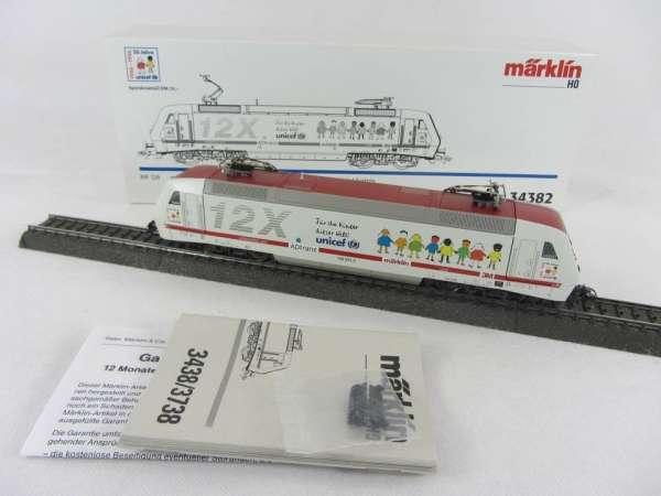 Märklin 34382 Baureihe 128 001-5 E Lok 12X Unicef guter Zustand und mit OVP